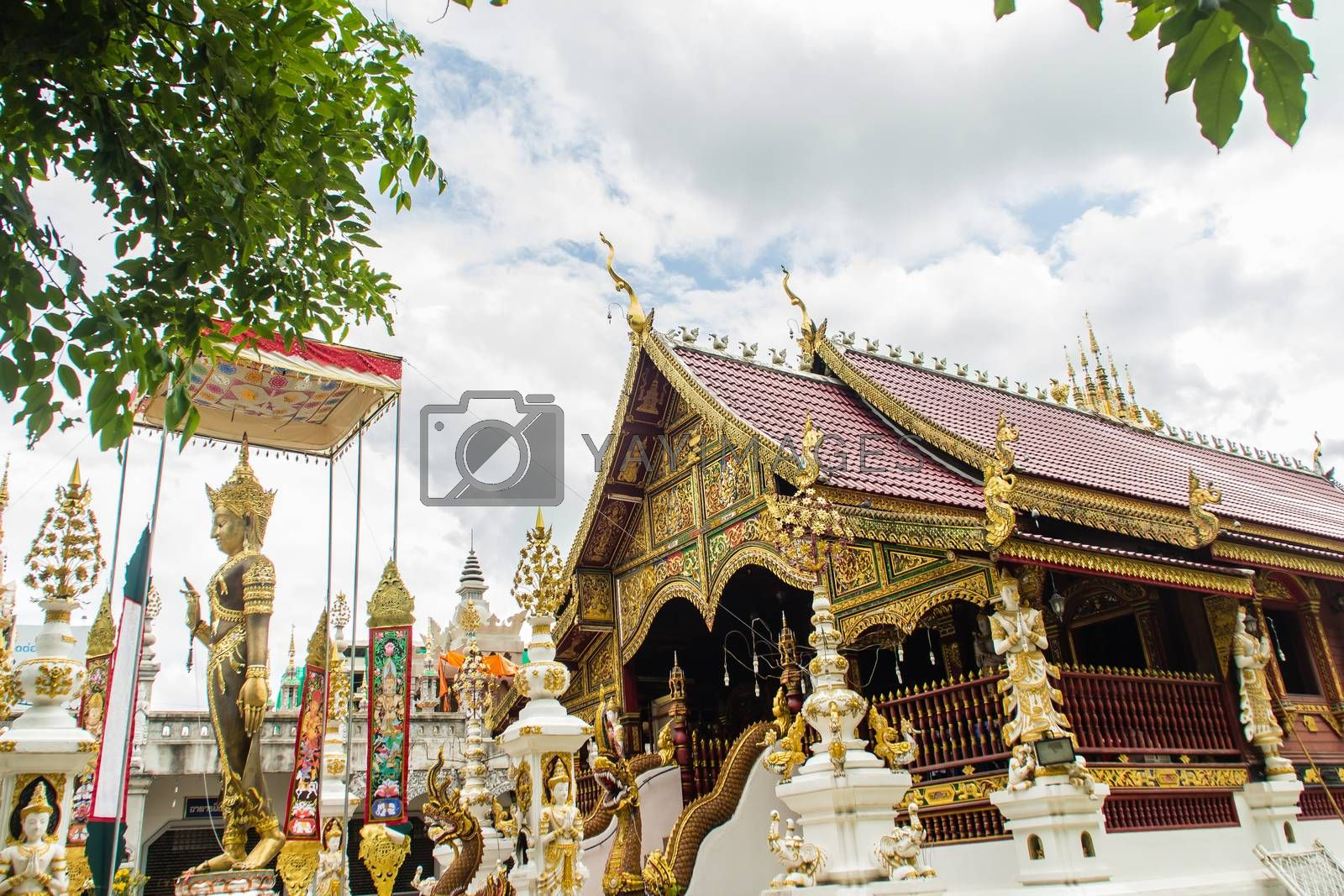 Beautiful art, religious places and religious objects in Myanmar mixed with Lanna style at Wat Ming Muang Buddhist temple, Chiang Rai, Thailand. Mixed Lanna and Burmese arts.