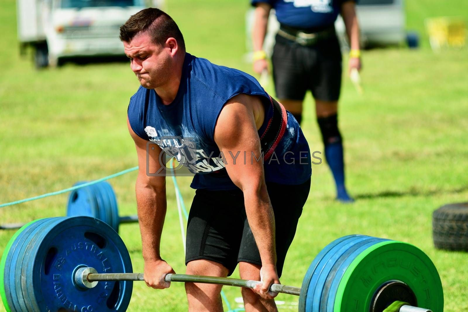Strongman training in a public park, log Lift and Deadlift training