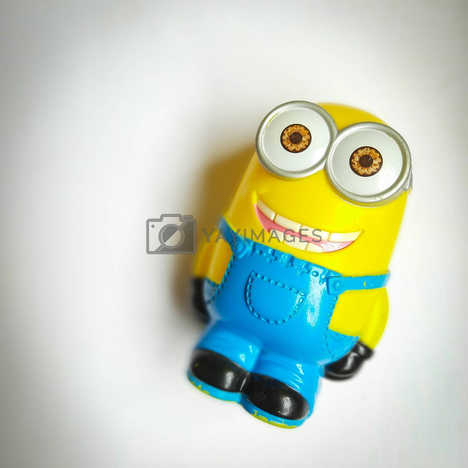 Chennai, India - July 2 2020: Minion toy shape piggy bank placed in white background