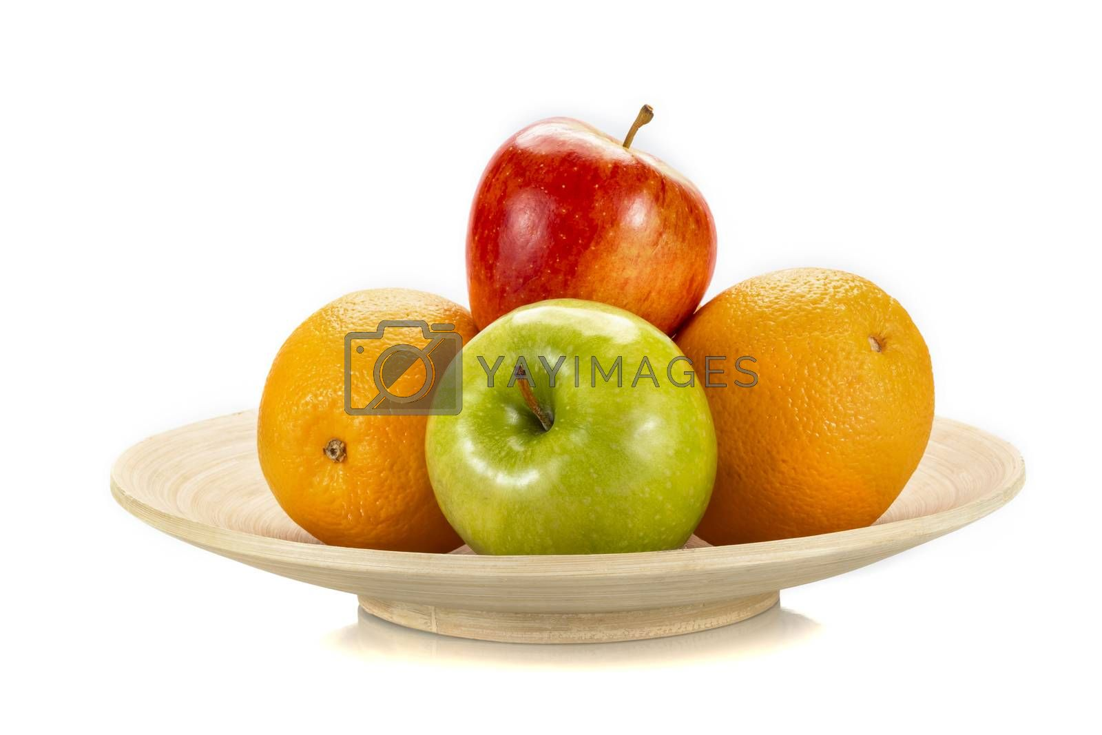Fresh fruits  on a bamboo plate, isolated on white background.