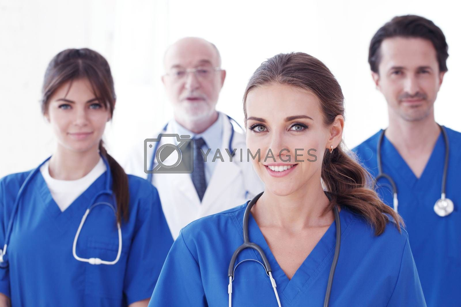 Team of professional doctors in blue uniform isolated on white background