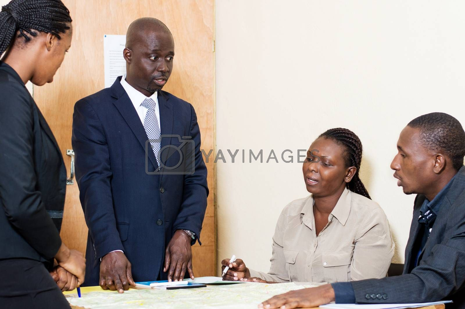 Business colleagues meet in a meeting at the office to discuss their work plans.