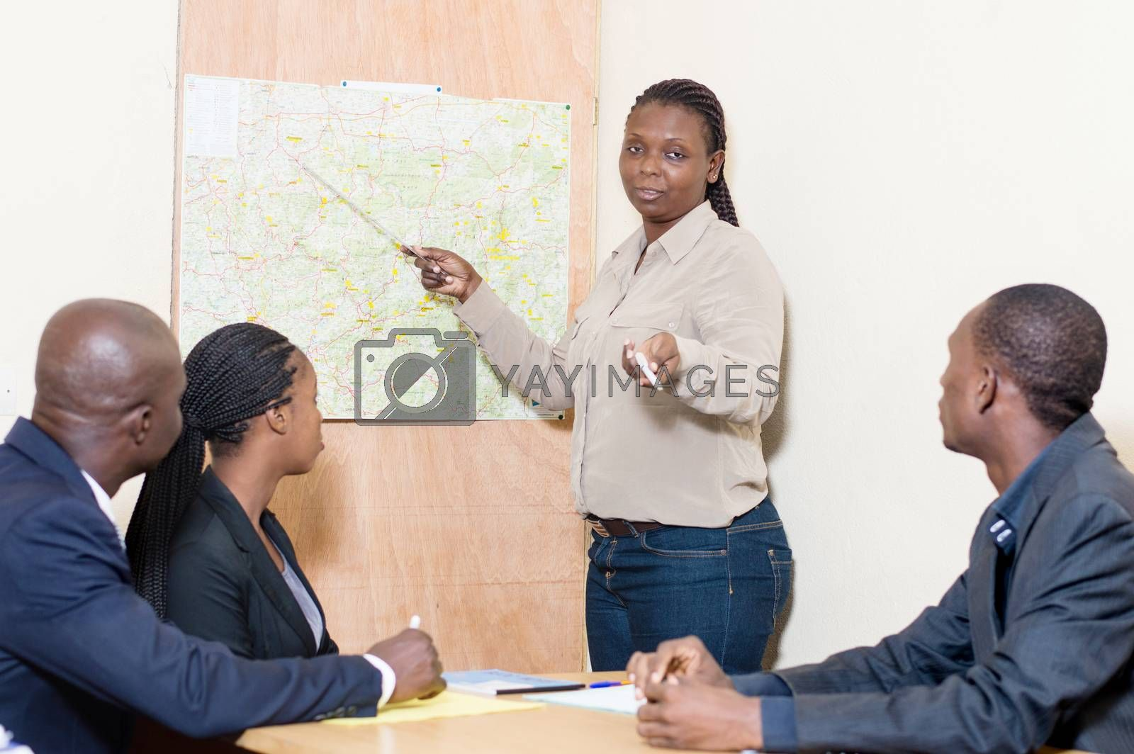 Young businesswoman makes the presentation of the company at the company meeting.