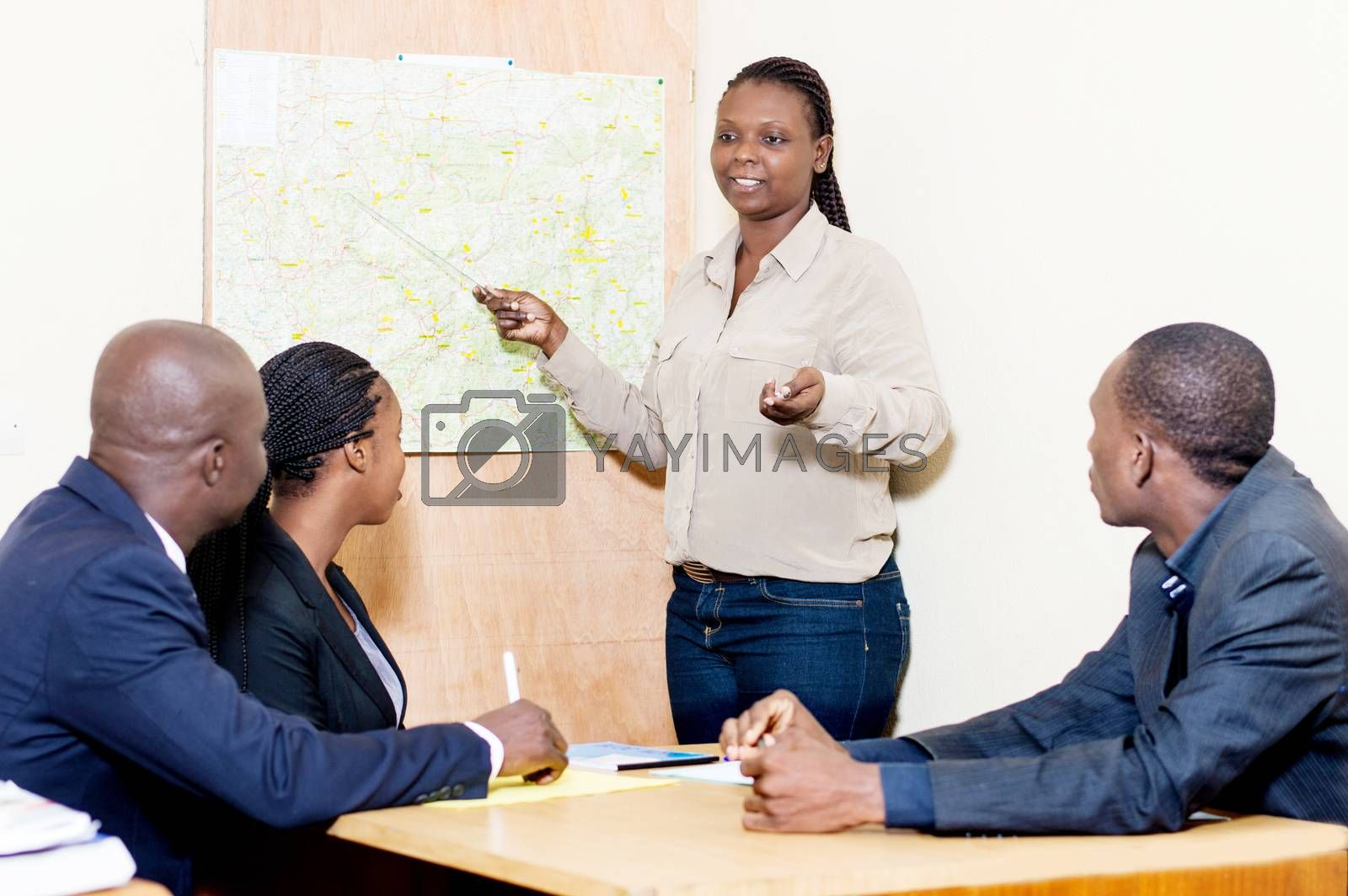 Young businesswoman makes the presentation of the company at the company meeting