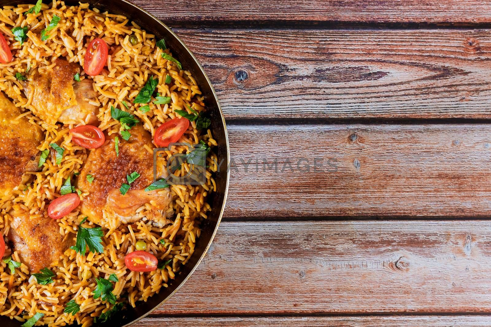 Healthy food fried rice chicken with parsley and tomatoes
