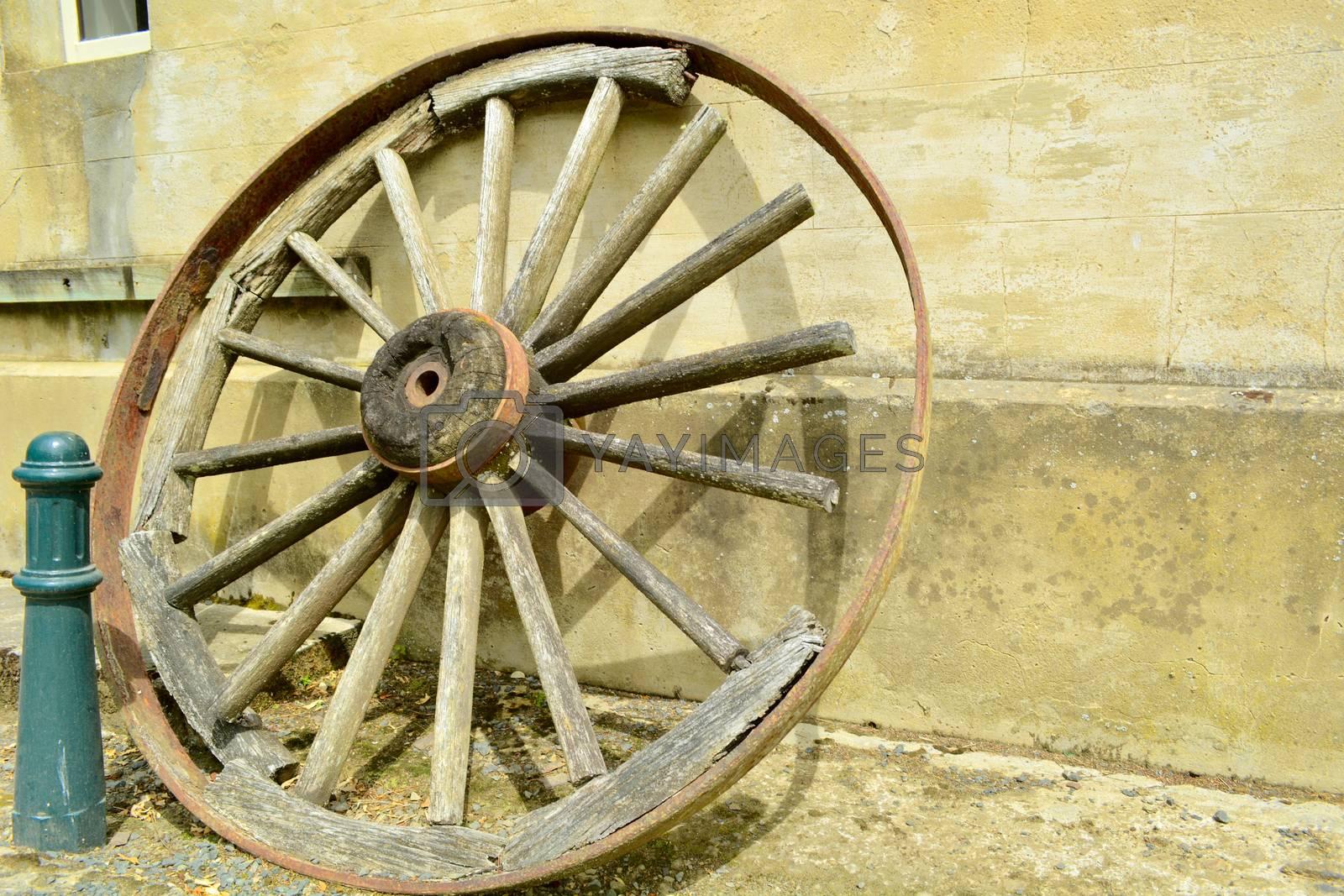 Old broken wooden wheel