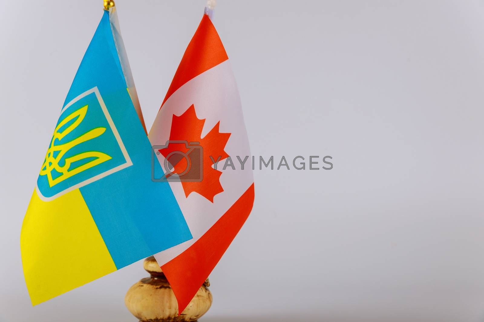 Canadian flag and Ukrainian national flags. Symbol of Canadian Ukrainian friendship by ungvar