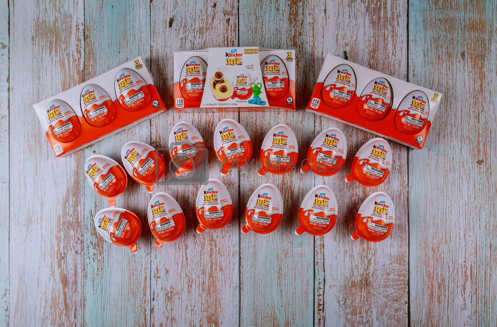 Kinder Surprise chocolate eggs are a confection manufactured by Ferrero company and containing a small toy. by ungvar