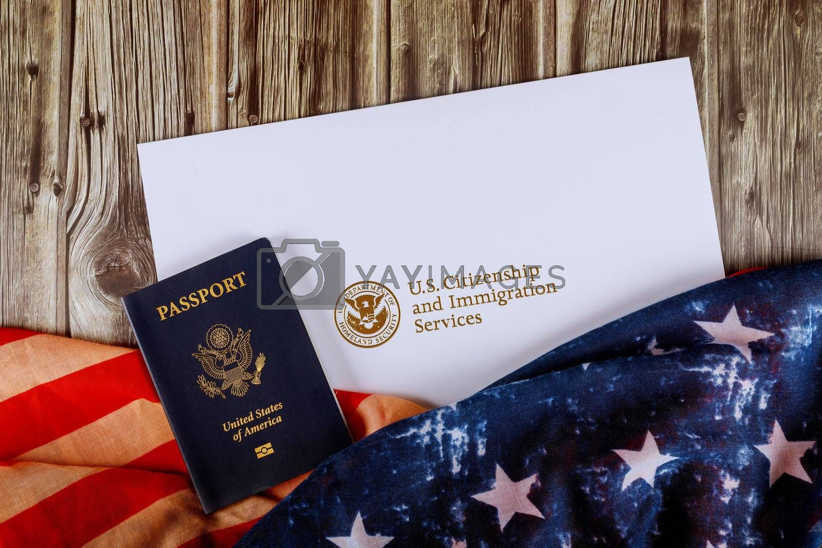USA passport and citizenship naturalization certificate of US flag over wooden background