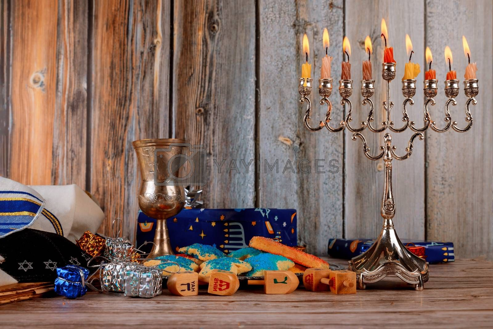 Hanukkah with menorah jewish holiday traditional Candelabra and wooden dreidels spinning top