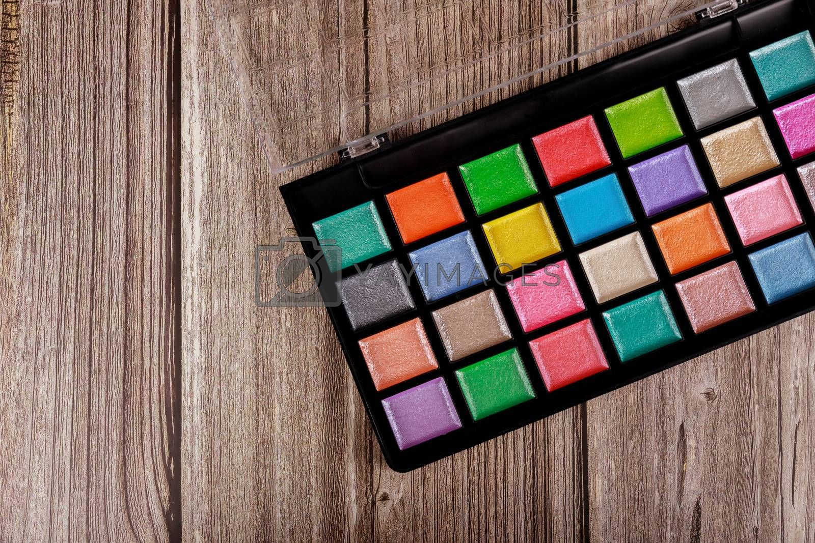 Make up palette, eye shadows in black box. Rectangular shape.
