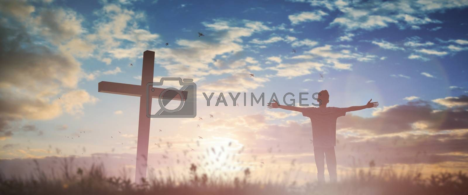 Happy man rise hand Worship God in morning view. Christian spirit prayer praise on good friday cross background. Male self confidence empowerment on mission arm concept strength ambitious