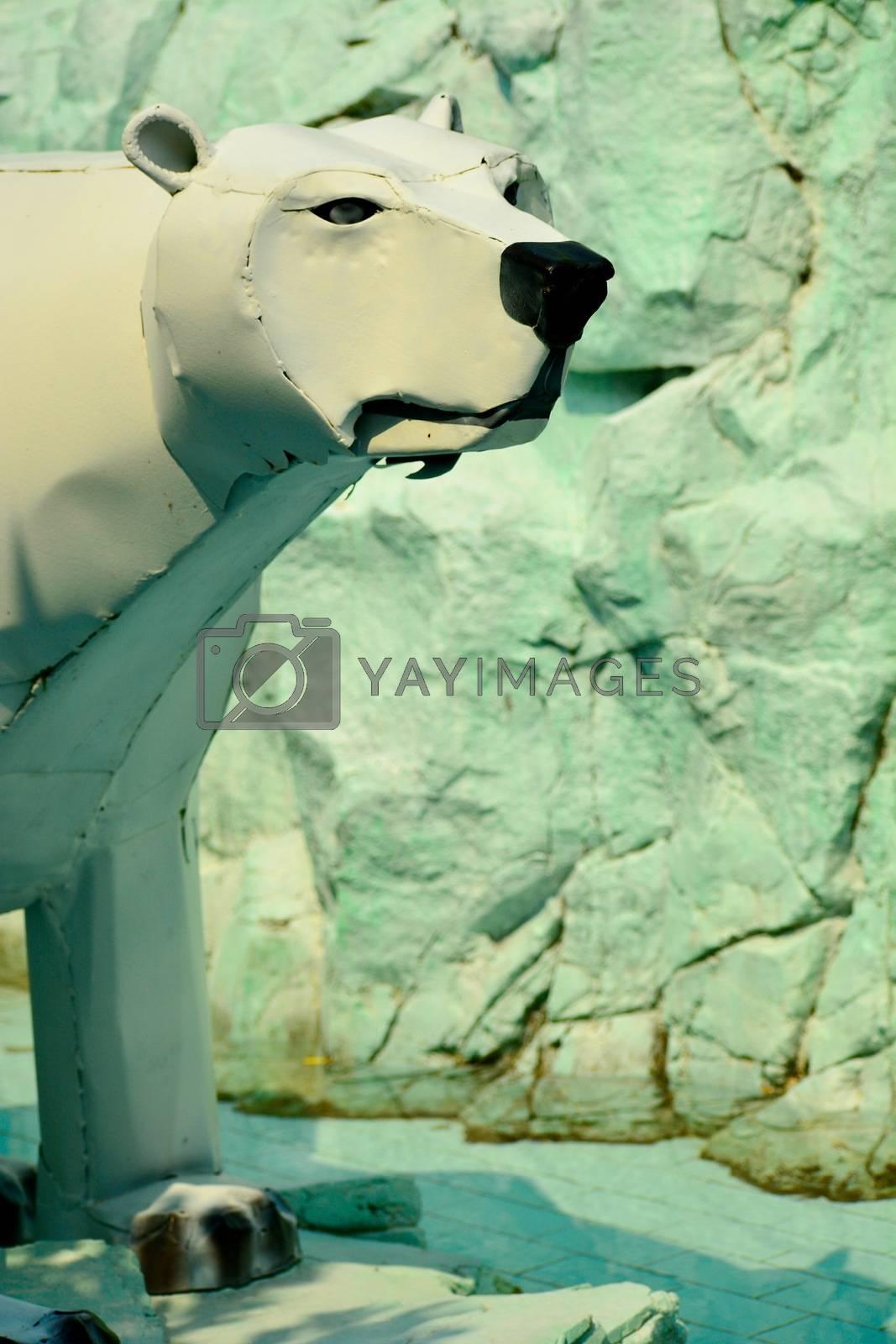 Modern garden sculpture; white bear made of broken washing machine parts
