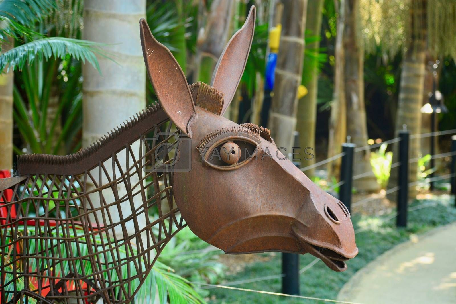 Peculiar modern sculpture made of rusty wire and some metal parts, representing a donkey.