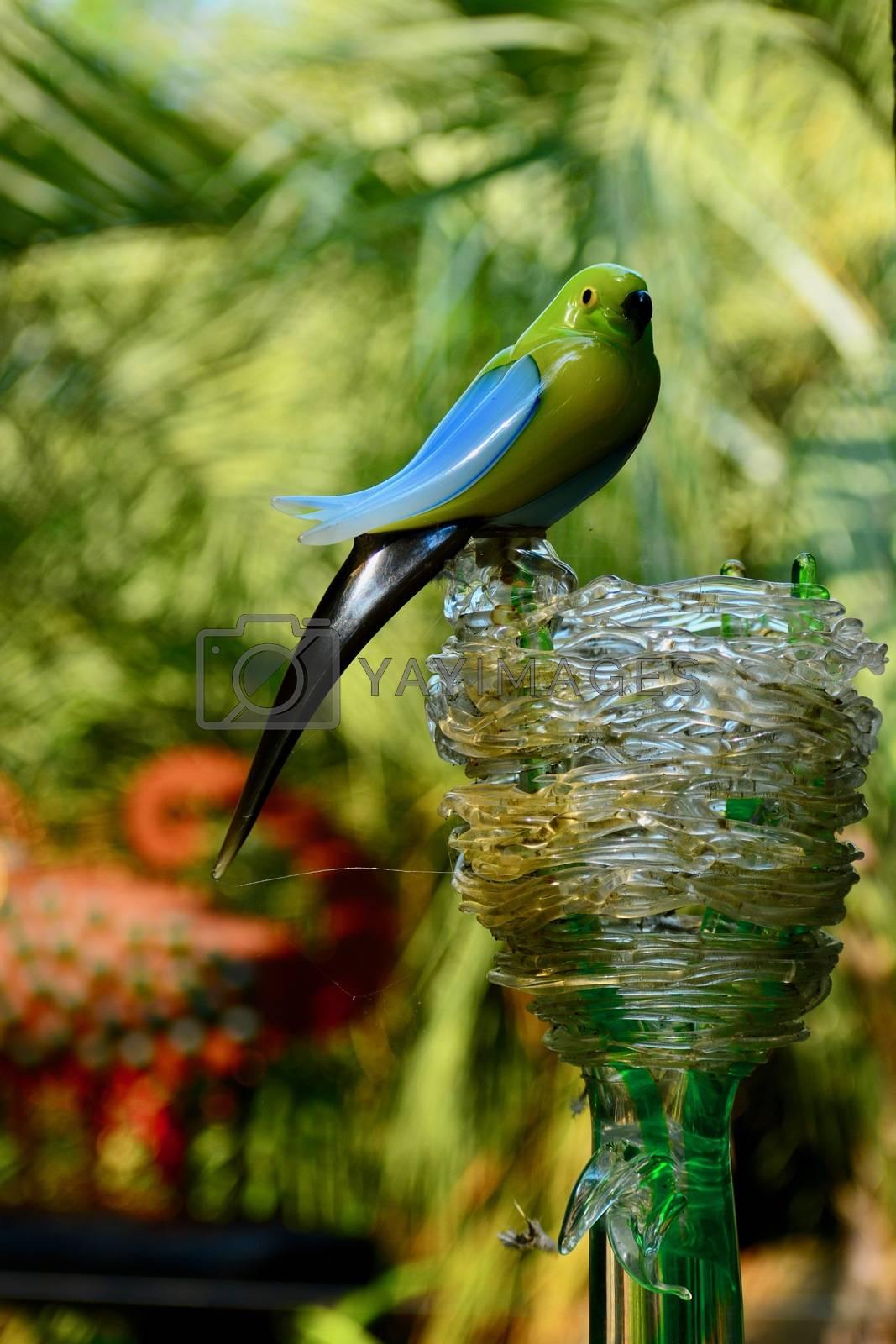 A cute porcelain sculpture representing a little bird next to its nest.