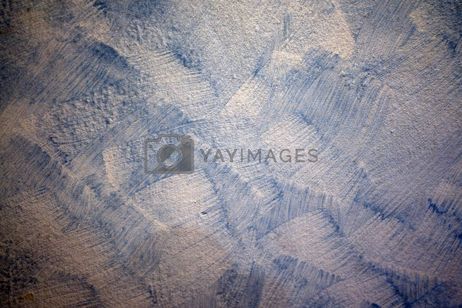 The blue and white cement wall surface is used as a vintage background.