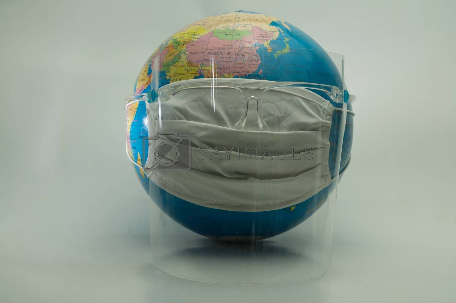 Globe simulates wearing medical masks to prevent the outbreak of COVID-19.