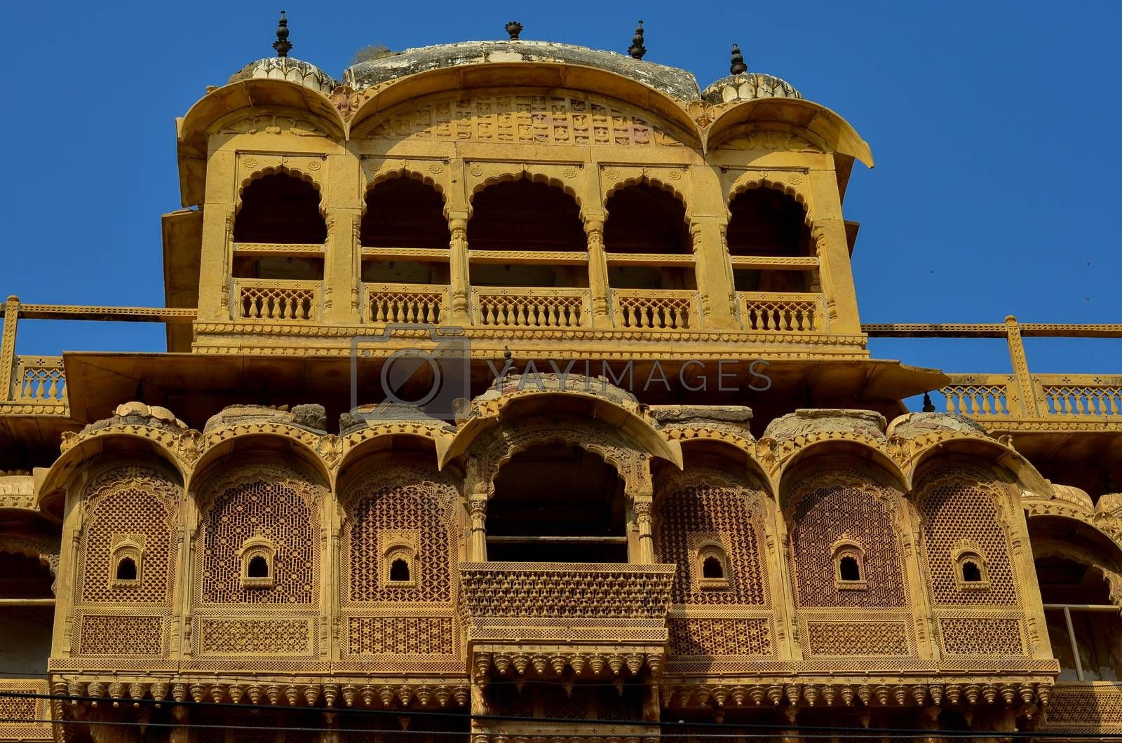 Facade of a traditional Rajasthani haveli with window at Patwon ki haveli in Jaisalmer, Rajasthan, India. Series of early-1800s palaces, now a museum featuring intricate carvings, furniture & artwork