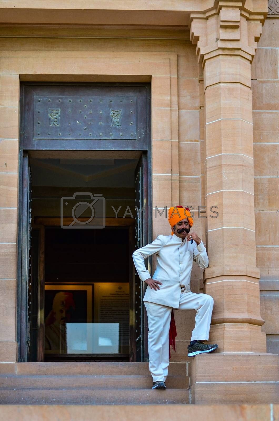 Jodhpur, Rajasthan, India, 2020. Guard with imposing mustache in front of a gate in Umaid Bhawan.