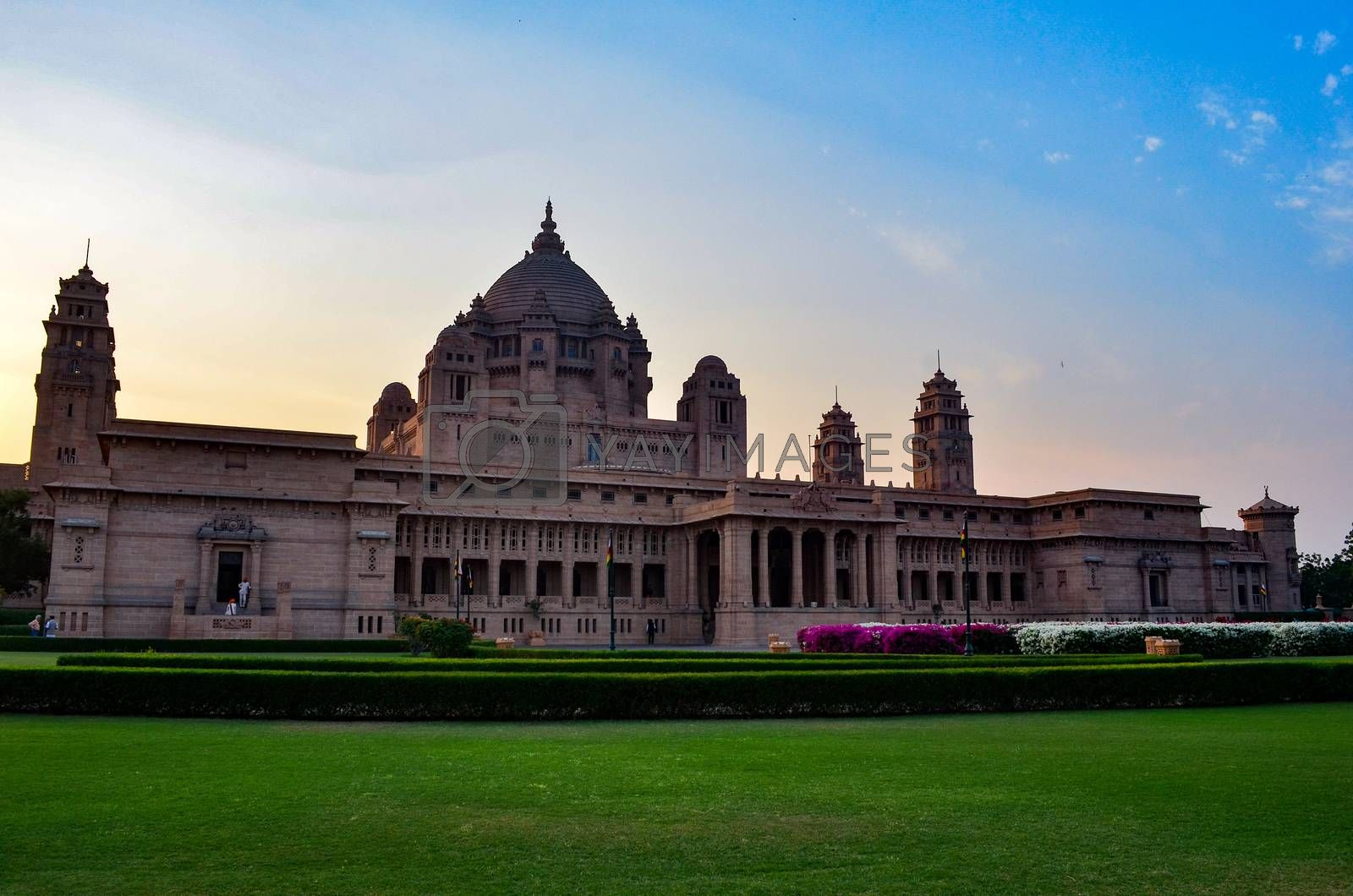 Majestic view of the Umaid Bhawan palace and hotel against a setting sun in Jodhpur, Rajasthan, India. This elegant hotel in a grand building was once home to the Jodphur royal family.