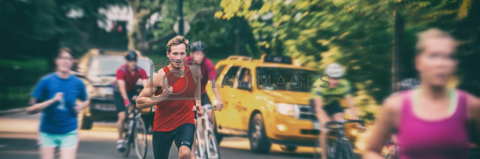 Fit runners motion blur people crowd training in city panorama banner - Athletes jogging, biking in New York city with yellow cabs cars background. Man running fast in blurred motion by Maridav