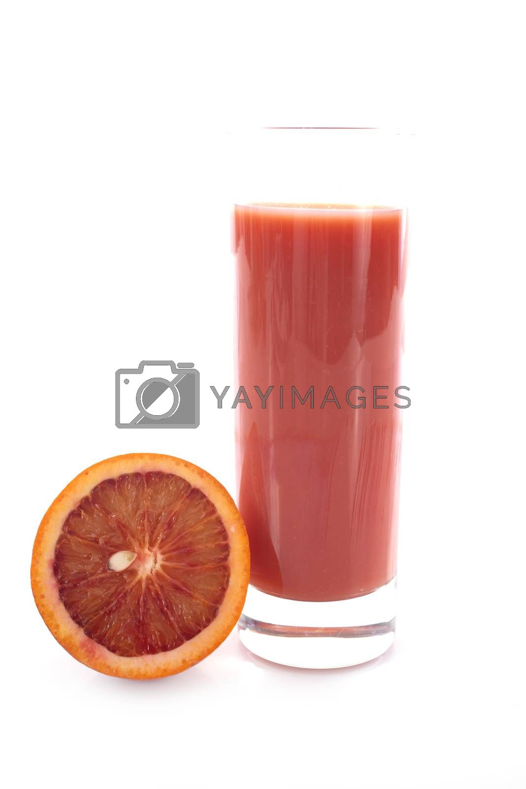 blood orange juice in front of white background