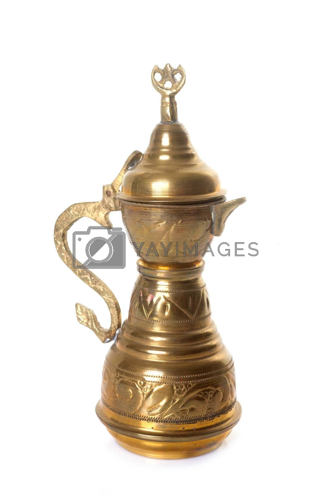 brass teapot in front of white background