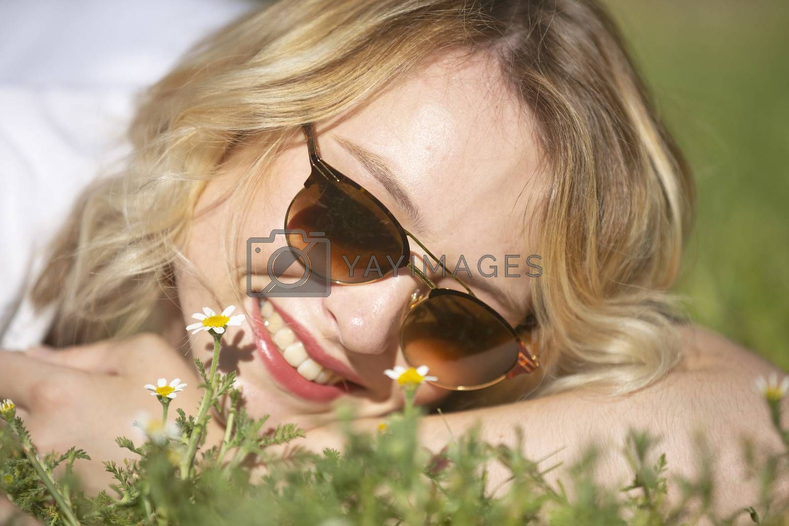 beautiful young blond woman resting in a garden