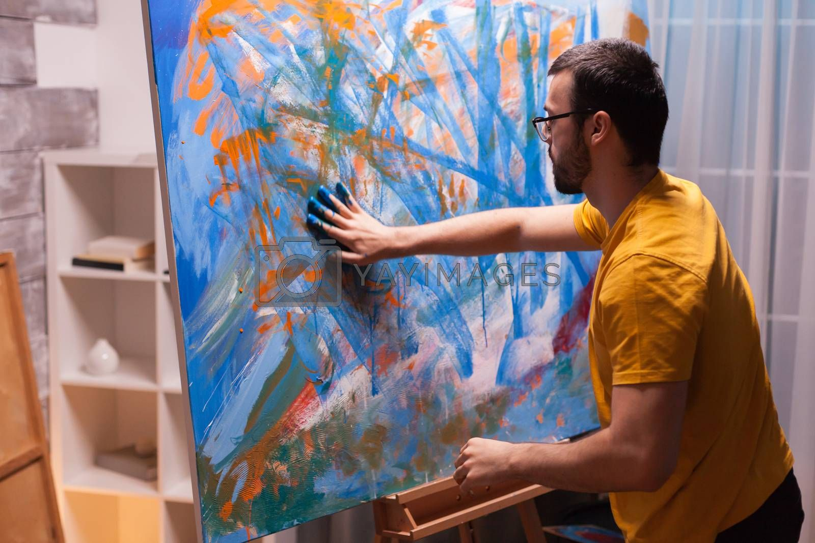 Successful artist in studio painting with hands on canvas. Modern artwork paint on canvas, creative, contemporary and successful fine art artist drawing masterpiece