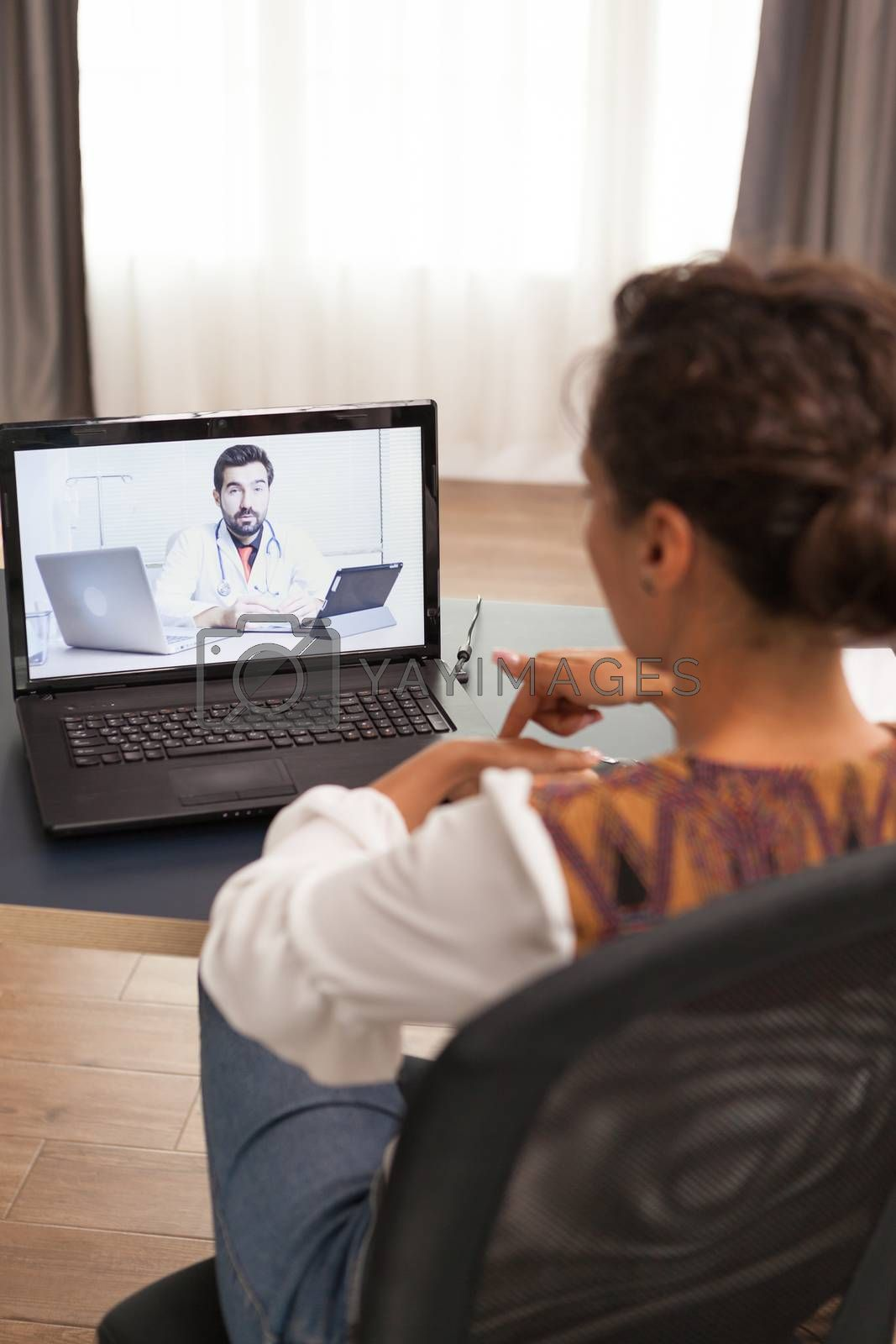 Woman during online consultation with doctor.