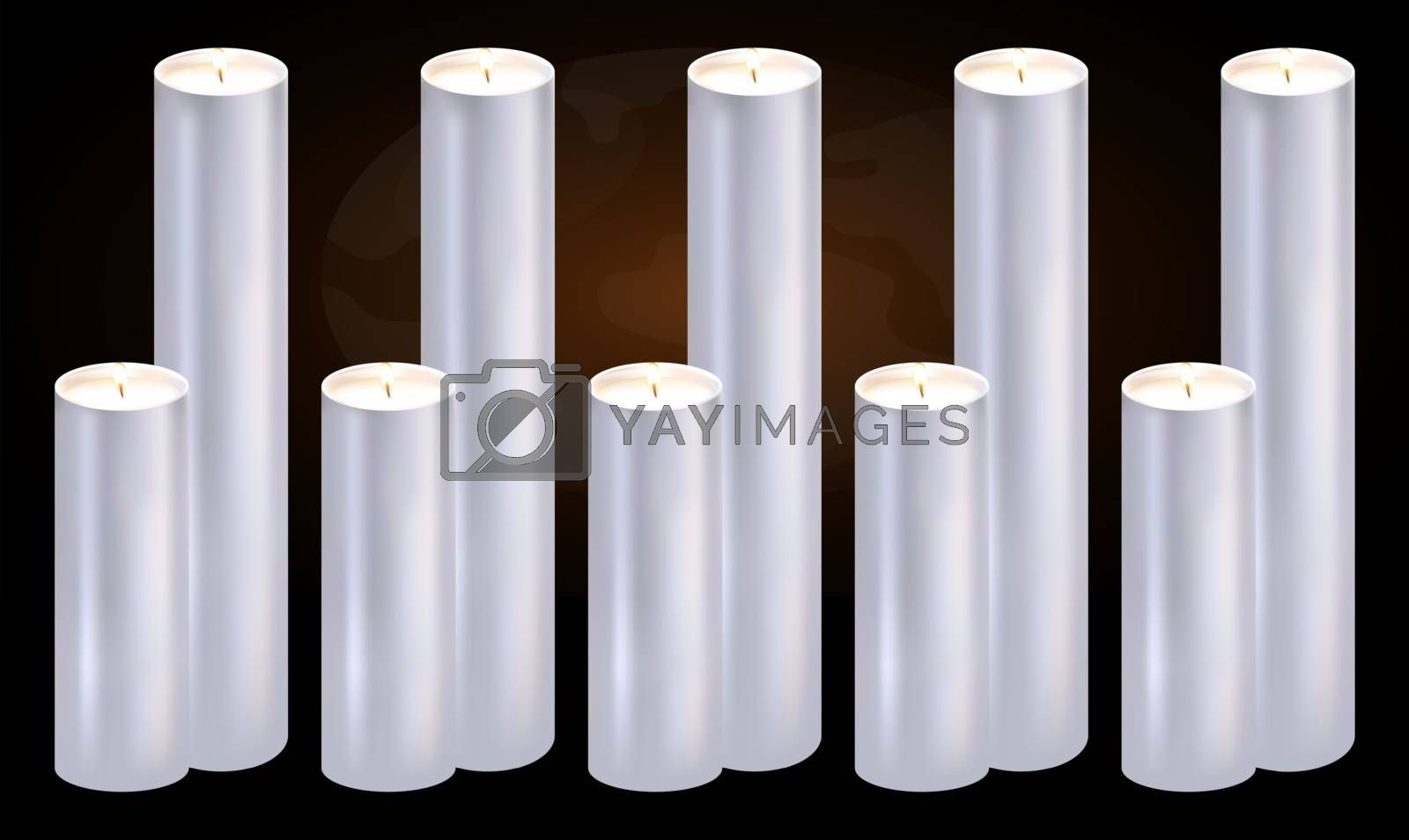several burning candles on abstract dark background