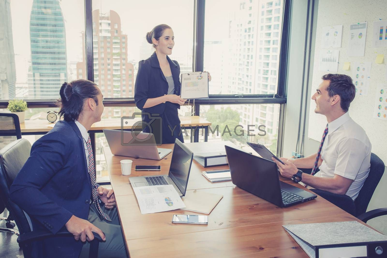 businesswoman presentation to a group in meeting. by nnudoo