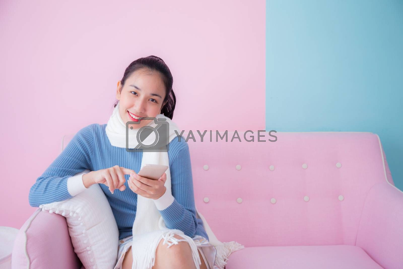 portrait of beautiful young woman relax on couch with smartphone communication concept.
