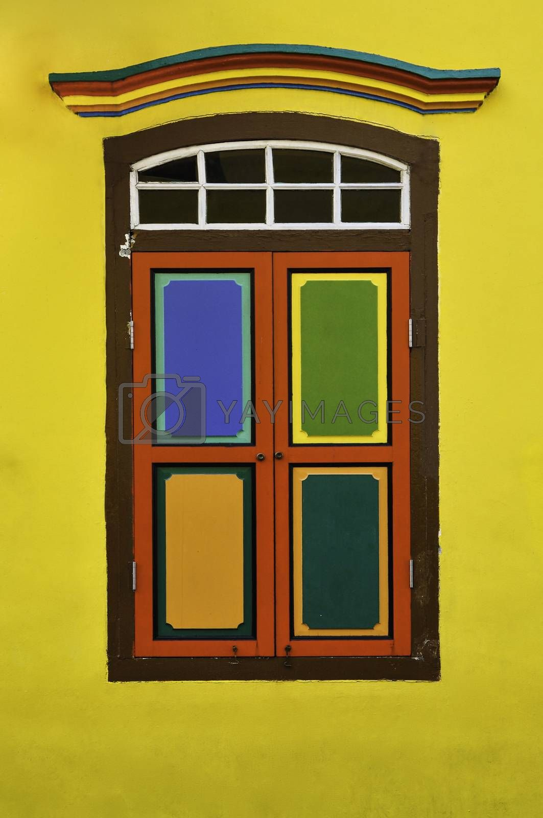 Closed colourful wooden shutters on a restored Hindu temple