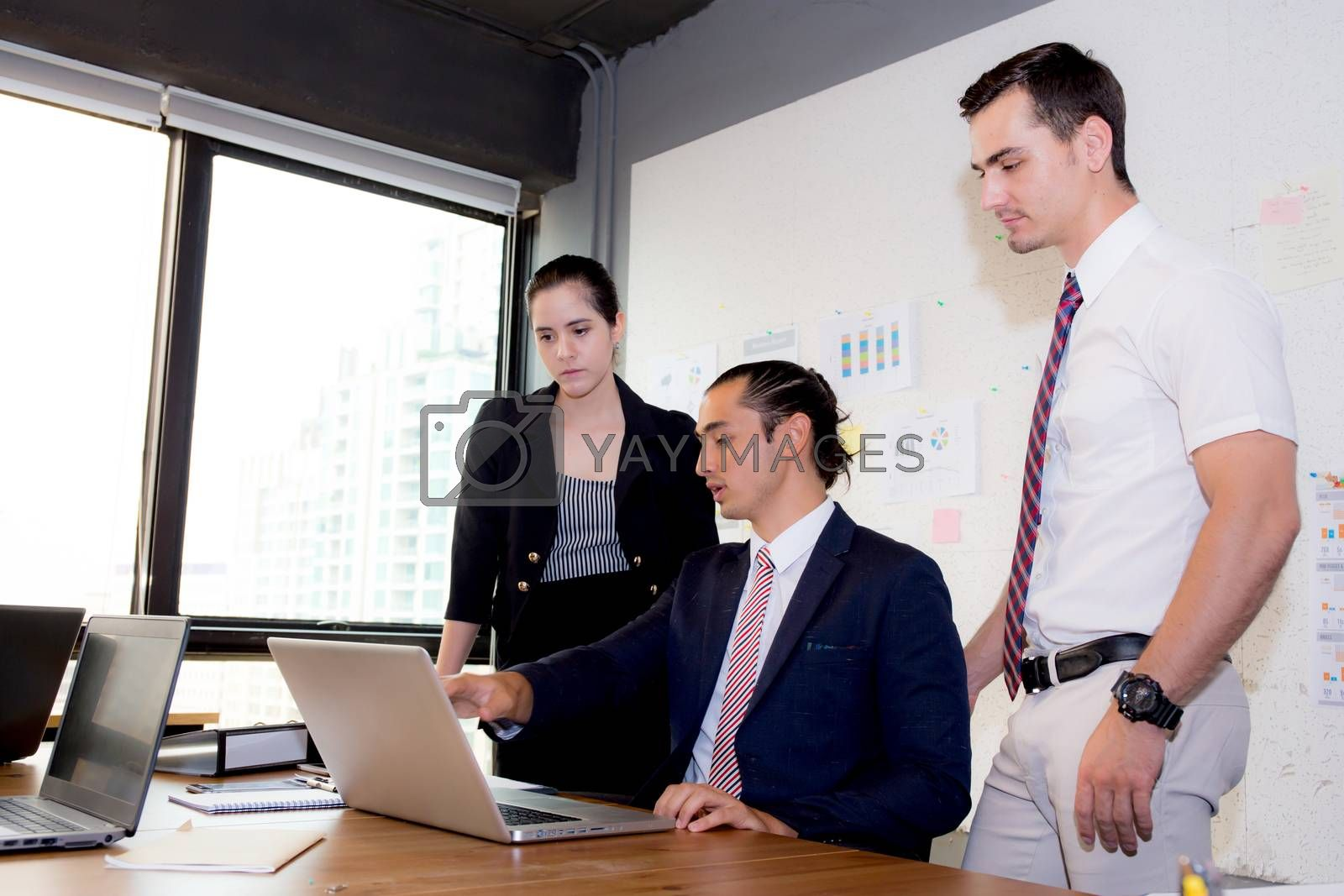 American people business team having using laptop during a meeting and presents.