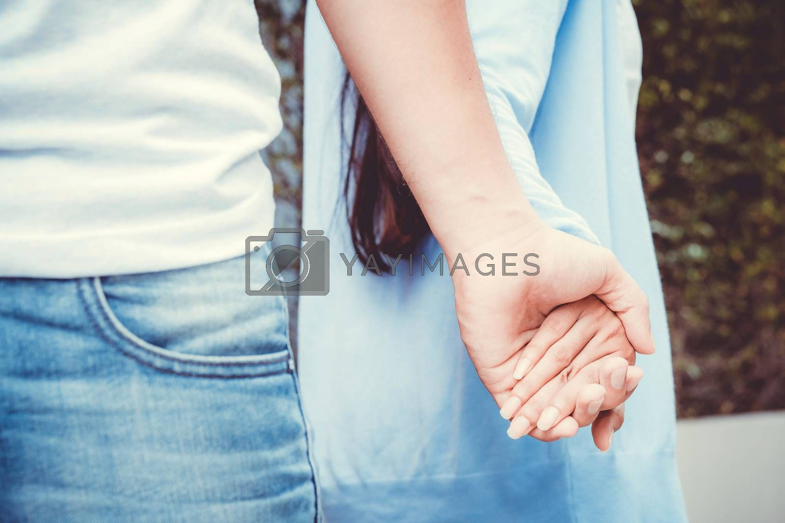 Hands with couple love together, Closeup of loving couple holding hands while walking outdoors.