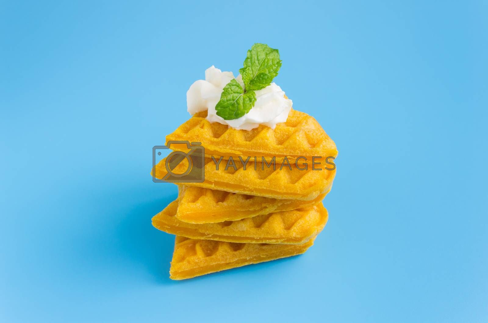 5 Pieces Waffle on Blue Pastel Background Minimalist Style. Heart shape waffle dessert in minimalist style for food and dessert category