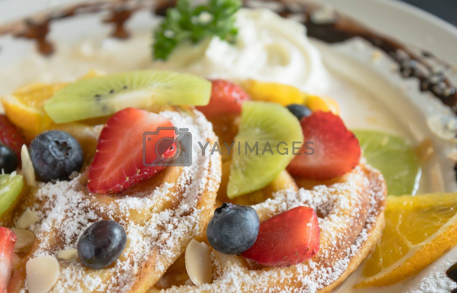Strawberry Blueberry Kiwi Lemon Waffle Whipped Cream Chocolate Dessert. Fruity dessert food and drink category