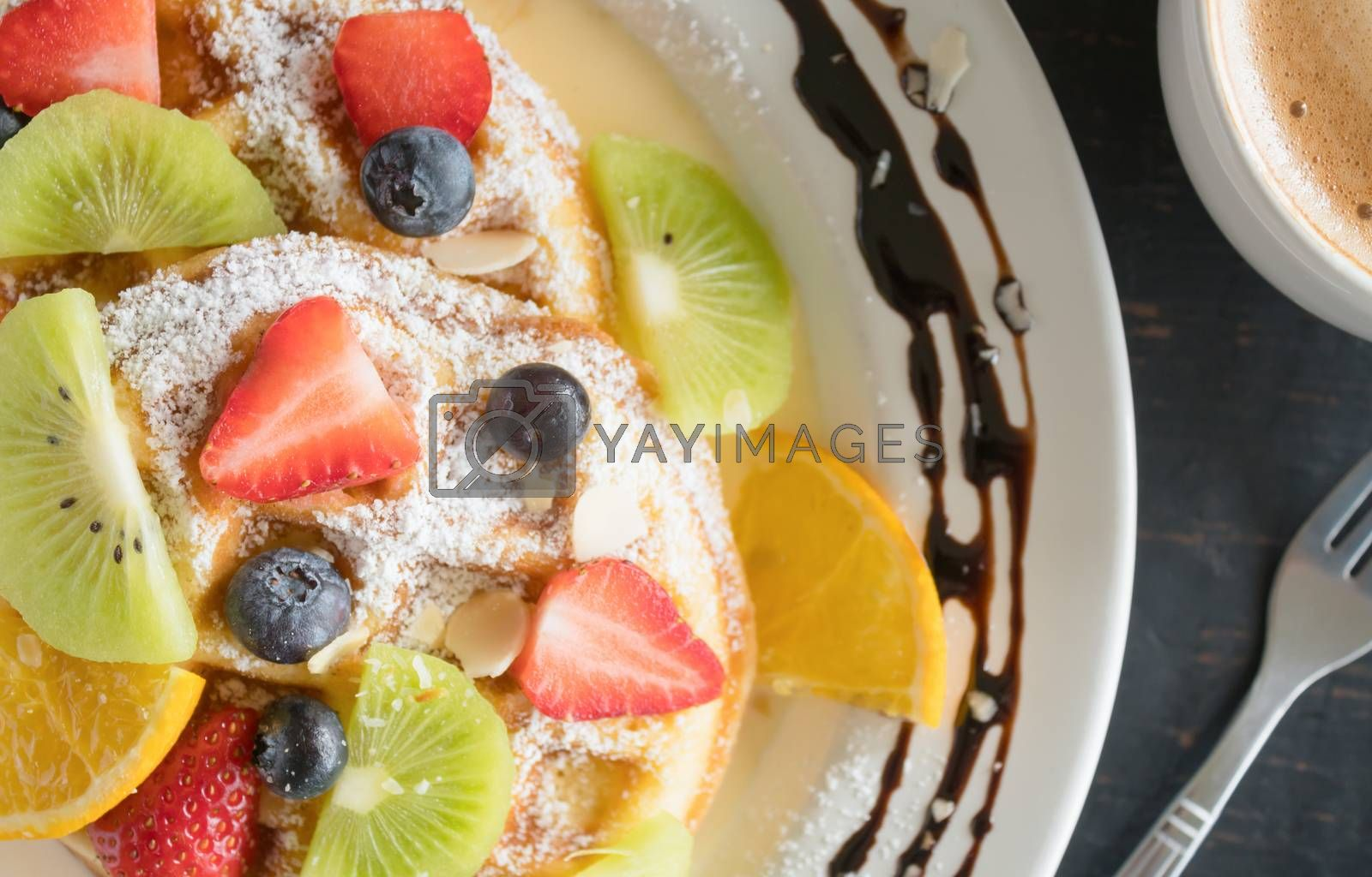 Flatlay Half Strawberry Blueberry Kiwi Lemon Waffle Chocolate Coffee Dessert. Fruity dessert food and drink category