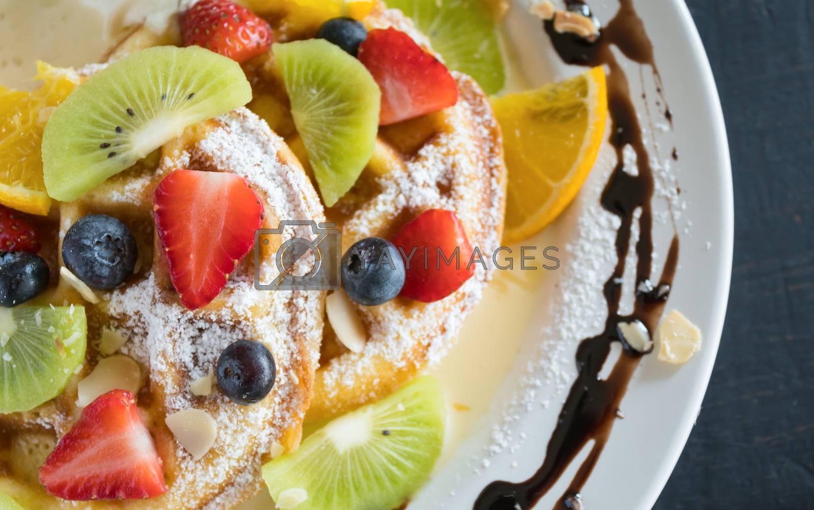 Flatlay Half Strawberry Blueberry Kiwi Lemon Waffle Chocolate Dessert. Fruity dessert food and drink category