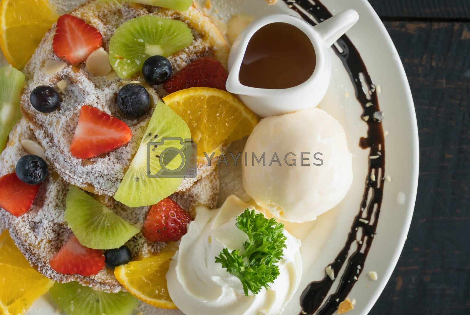 Flatlay Half Strawberry Blueberry Kiwi Lemon Waffle Whipped Cream Ice Cream Chocolate and Syrup Dessert. Fruity dessert for food and drink category