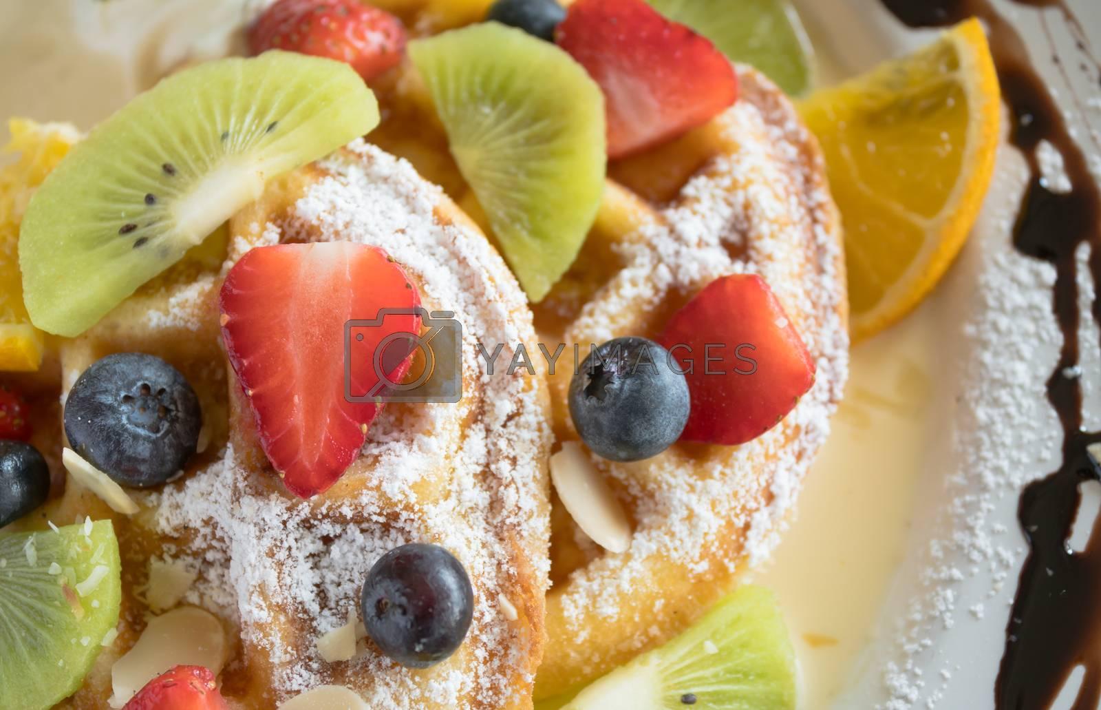 Flatlay Half Strawberry Blueberry Kiwi Lemon Waffle Chocolate Dessert Close Up. Fruity dessert food and drink category