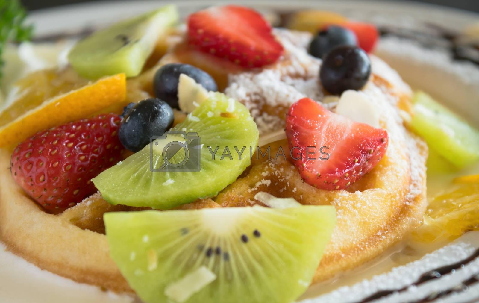 Kiwi Strawberry Blueberry Lemon Waffle Chocolate Dessert. Fruity dessert food and drink category