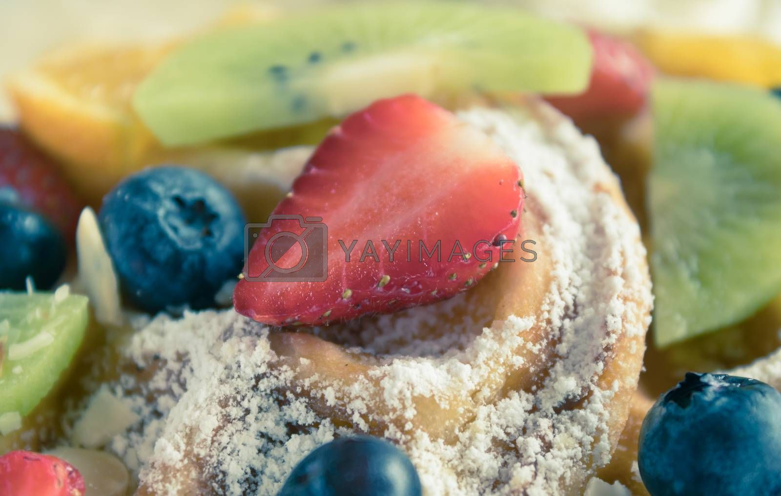 Vintage Strawberry Blueberry Kiwi Lemon Waffle Dessert Close Up. Fruity dessert food and drink category