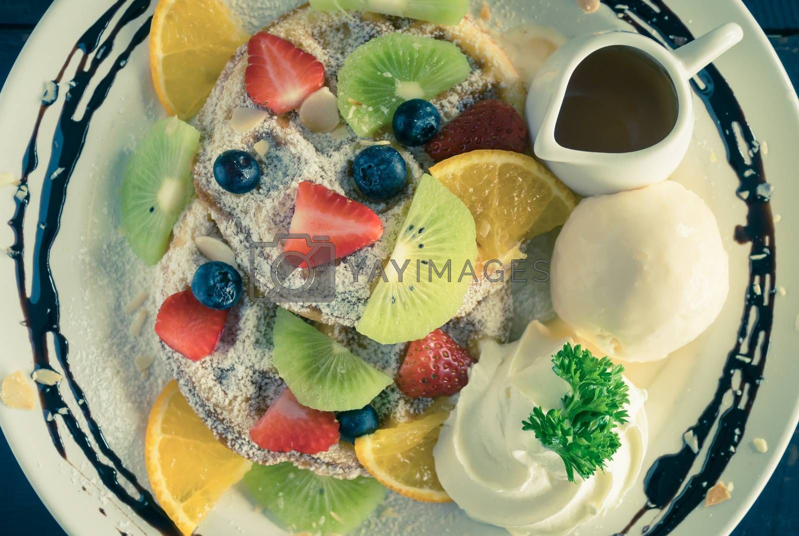 Vintage Flatlay Strawberry Blueberry Kiwi Lemon Waffle Whipped Cream Ice Cream Chocolate and Syrup Dessert. Fruity dessert food and drink category