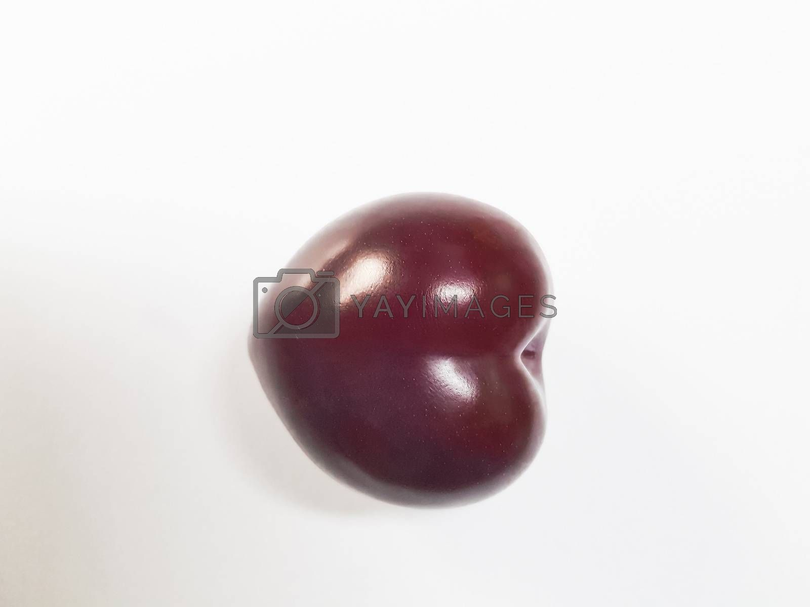 Isolated cherry. Sweet cherry fruits in the shape of a heart, isolated on white background.