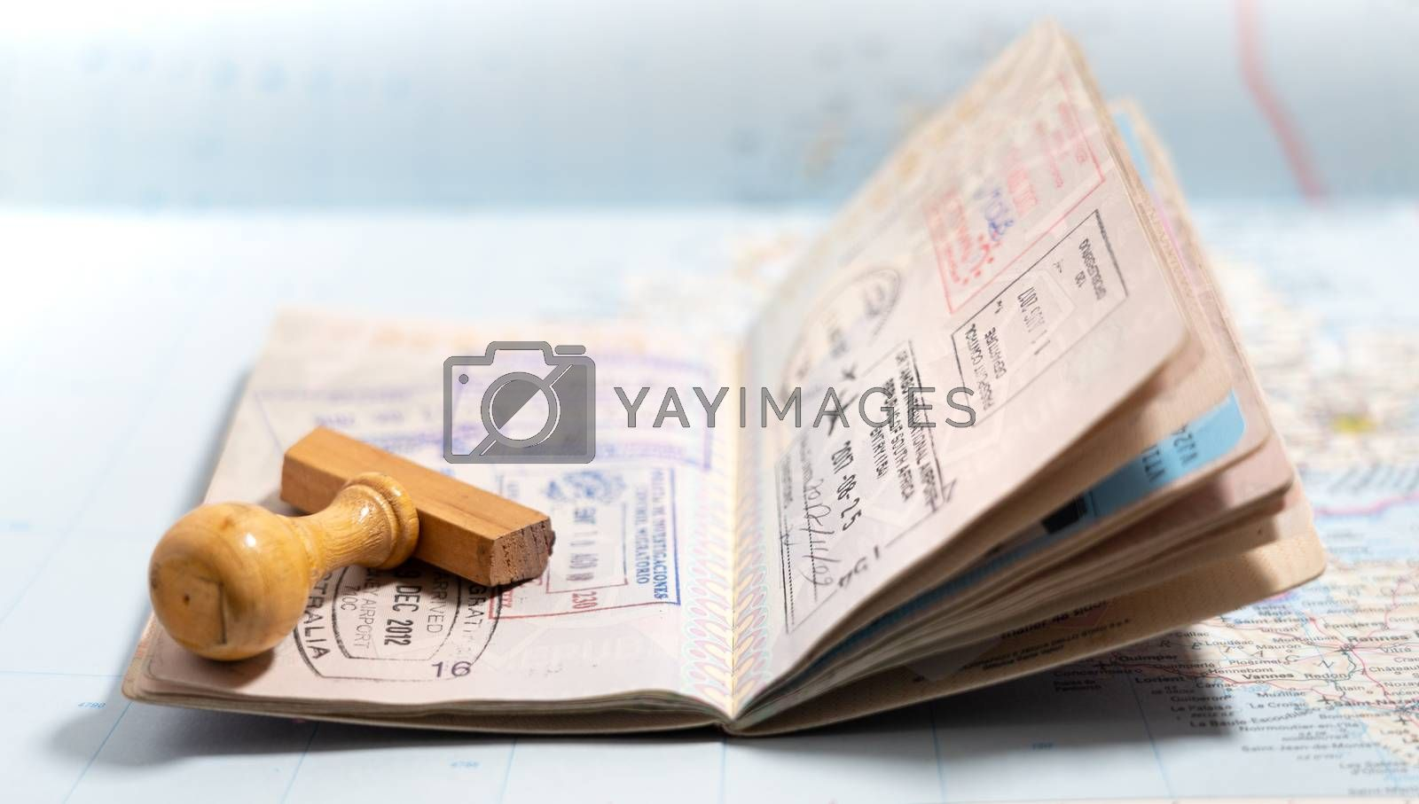 Royalty free image of Passport pages with a lot of visa stamps. by maramade