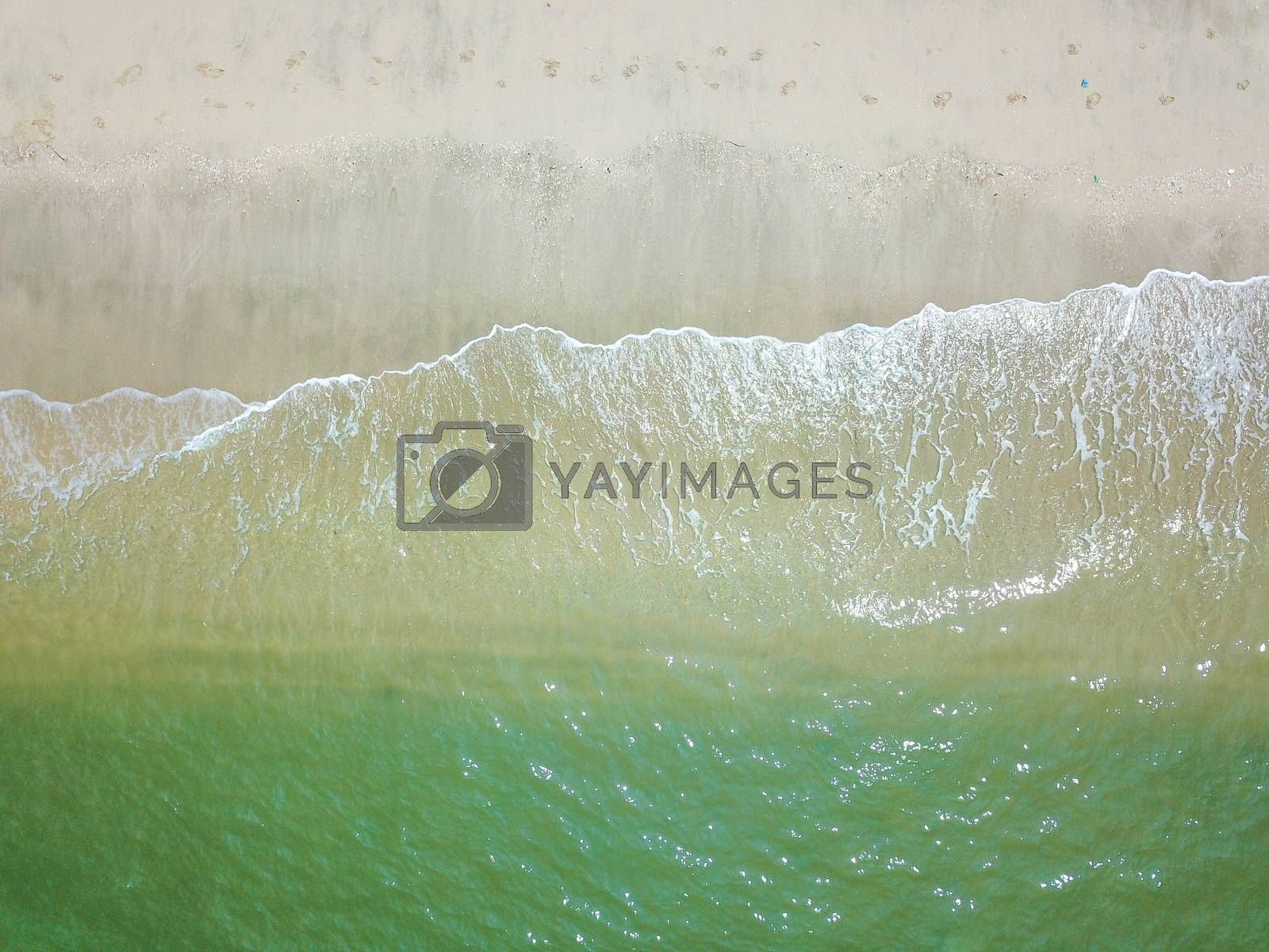 Blue ocean wave on clean sandy beach. Holidays and Travel Concept