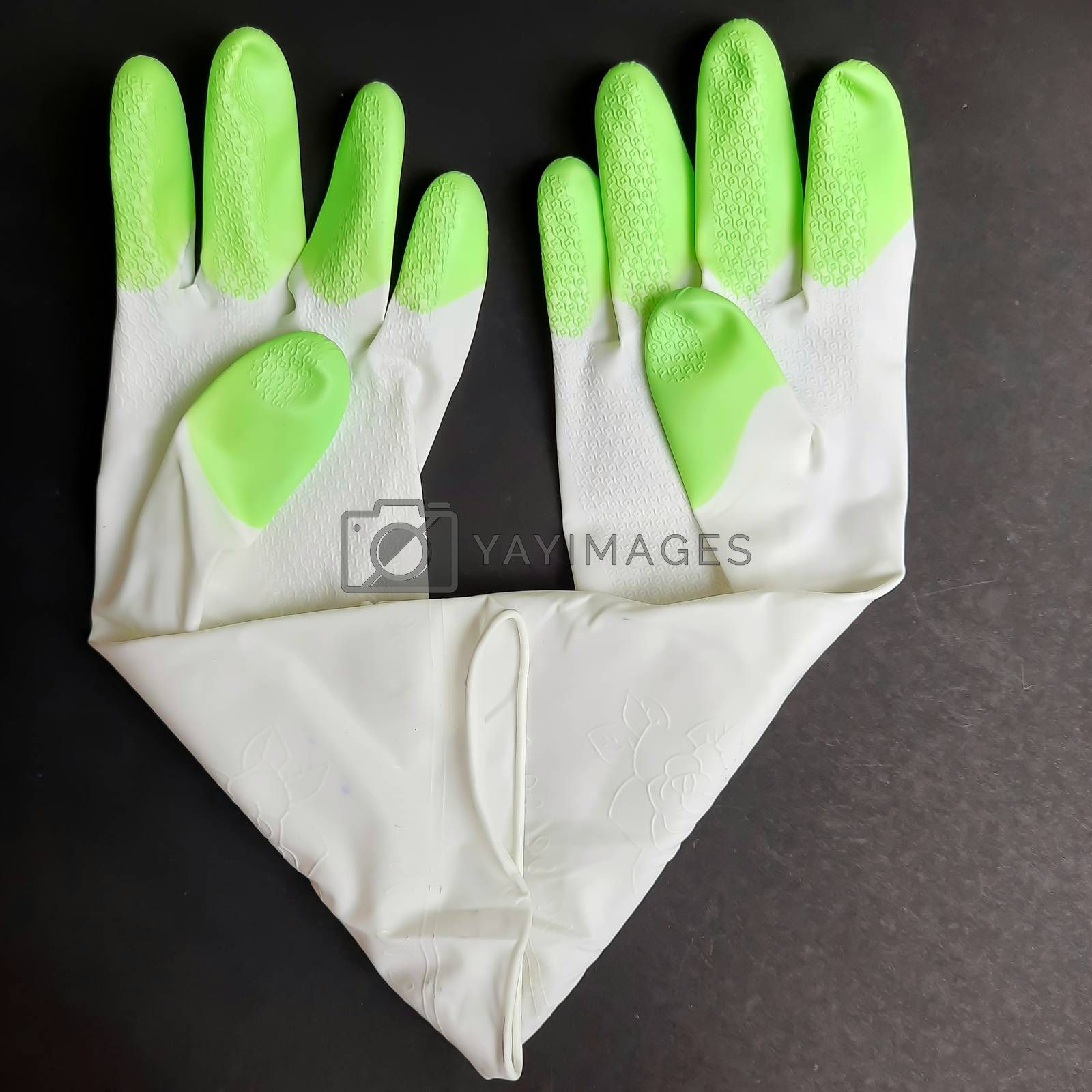Chennai, India - July 13 2020: Hand gloves kept in black chart as backgrounds used to wash and be safe during covid-19
