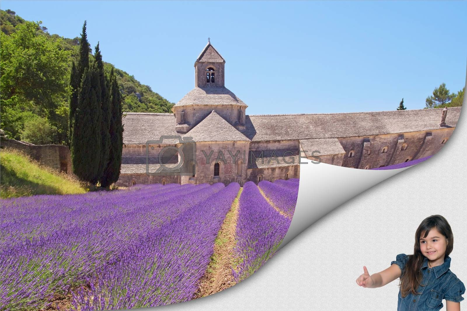Cute tanned little girl standing in an exposed corner is pointing at the famous Senanque Abbey in colorful lavender field. Gordes, Provence. France.